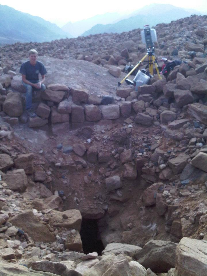 Field Assistant Ross Davison and the Leica Scanstation 2 working on the Looter's Pit of Khirbat Faynan in the foreground.