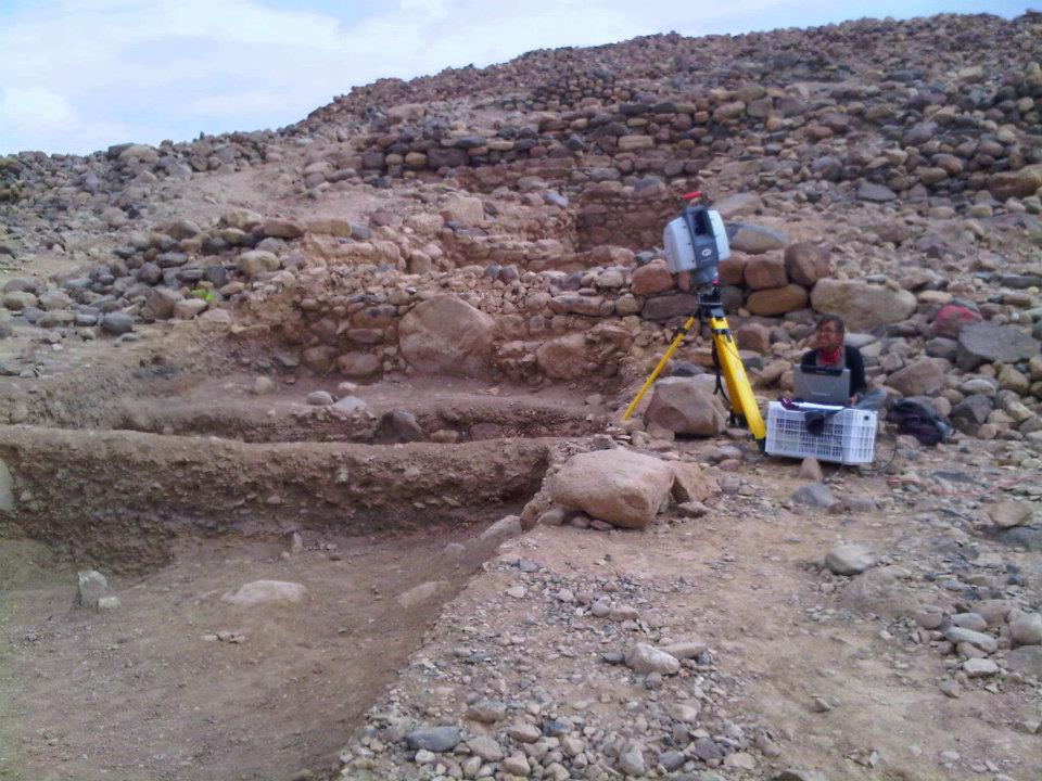Field Assistant Leah Trujillo setting up the Leica Scanstation 2 to digitize the shallow excavation area at the base of Khirbat Faynan's western slopes.