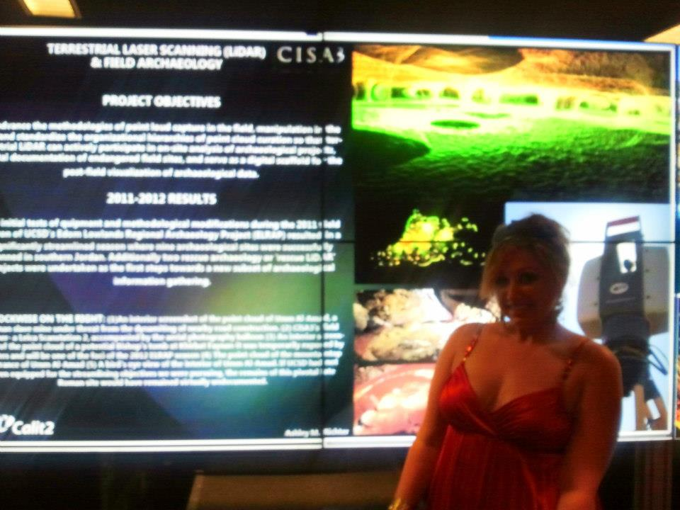 Ashley M. Richter in front of an Optiportable display of her recent work at the SME Building opening.