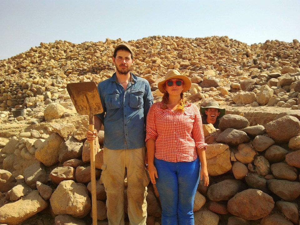 Archaeologists Aaron Gidding and Ashley M. Richter as  Jordanian Gothic in front of Aaron's excavation at Khirbat Faynan.