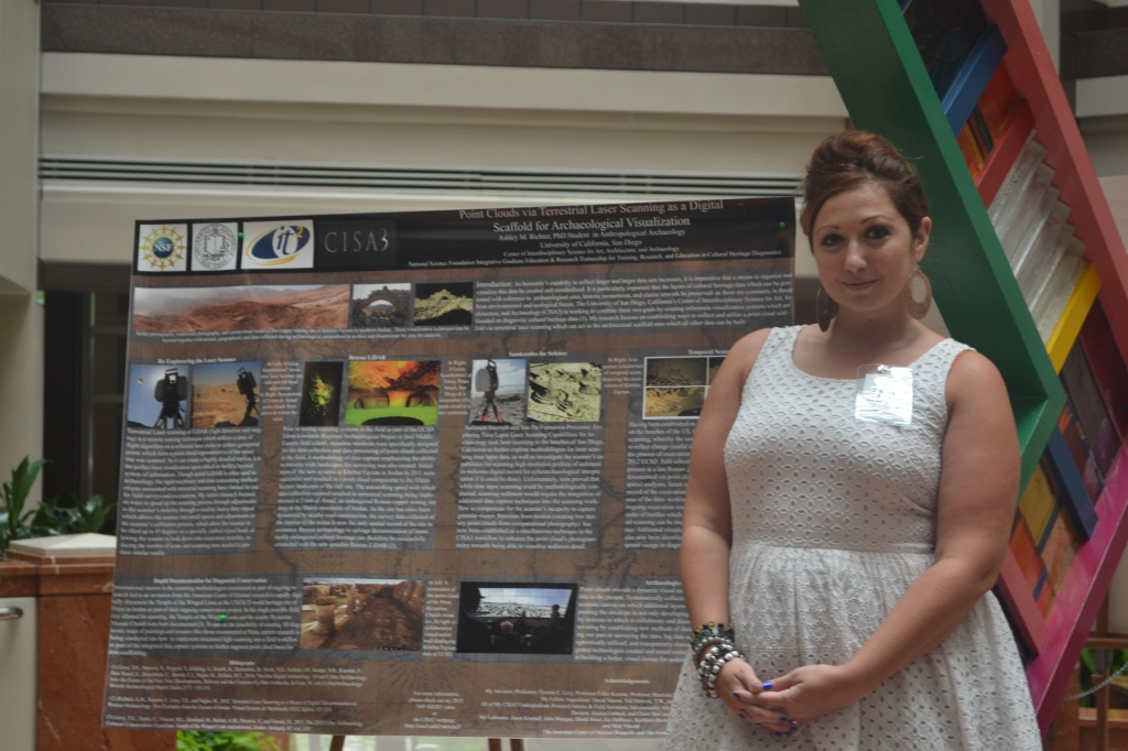 Ashley M. Richter in front of her poster at the National Science Foundation IGERT Poster and Video Competition.