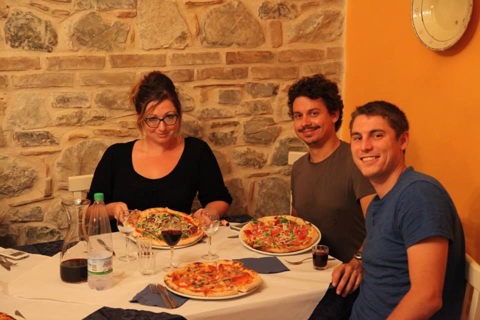 Mike Hess, Vid Petrovic, and Ashley M. Richter about to devour the pizza deliciousness served at the La Casa Incantata Pizzeria in Rocca Imperiale.