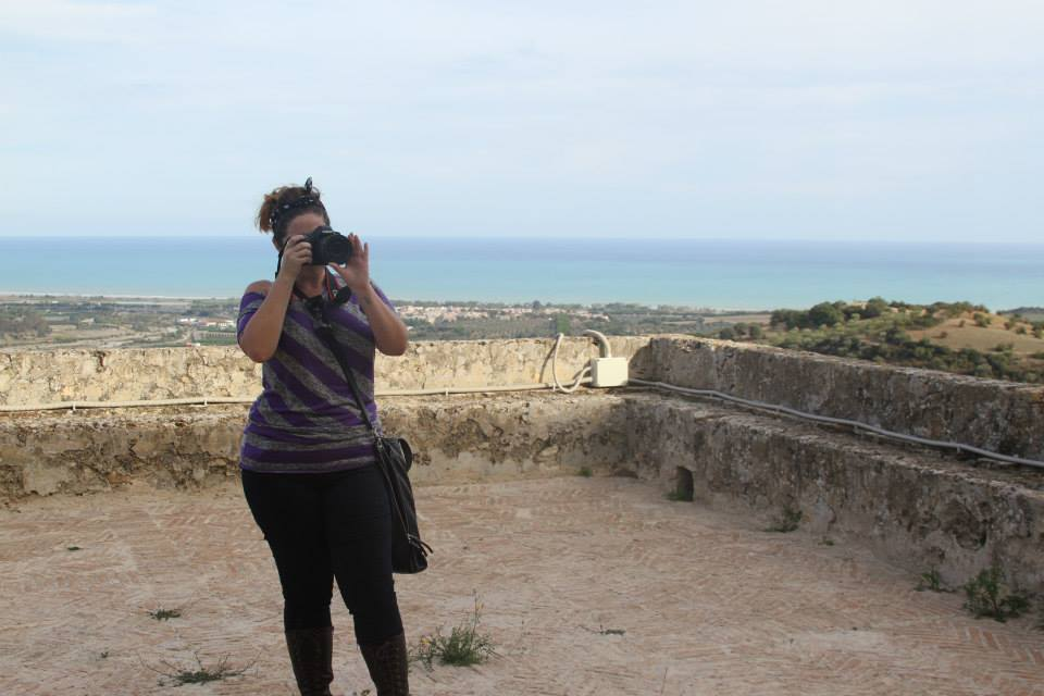Ashley M. Richter photographing Castello Svevo di Rocca Imperiale on the initial tour day.