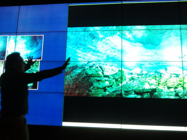 Archaeologist Beto Nava experiencing his data on the V-Room wall during a collaborative brainstorming session of how layered realities and digital data annotation could help their underwater project.