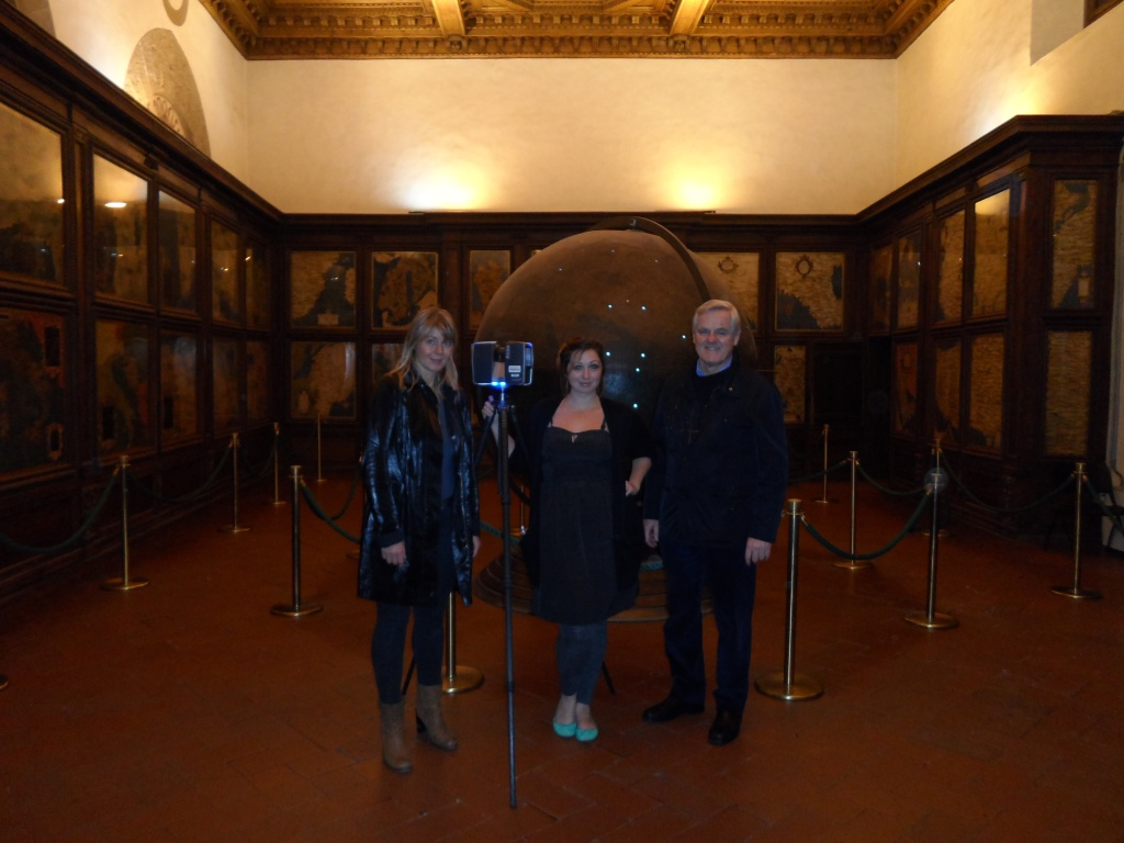 Art historian Katharina Giraldi-Haller, digital archaeology Ashley M. Richter, and foremost cultural heritage diagnostician Maurizio Seracini with the Faro Focus 3D in the Hall of Geographical Maps in Florence's Palazzo Vecchio.